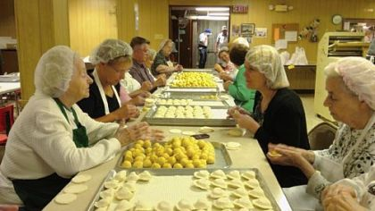 "Tami Dixon, at center right, joins the pierogi production line at St John the Baptist Ukrainian Catholic Church, South Side, and engages in conversations that helped her form the script for ""South Side Stories."""