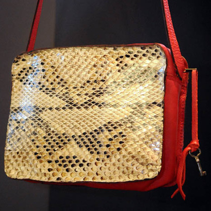 Python purse with red leather trim.