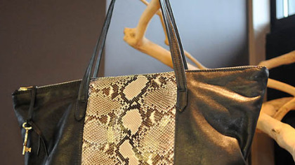 Python with black leather handbag.