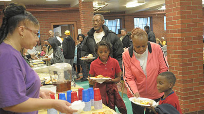 Residents take part in a community dinner Saturday at the Warrington Recreation Center.