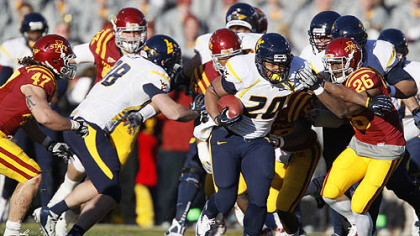 Iowa State defensive back Deon Broomfield (26) chases down West Virginia running back Shawne Alston (20) during the first half of an NCAA college football game Friday, in Ames, Iowa.