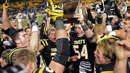 North Allegheny teammates celebrate their 21-14 win against Woodland Hills Friday in the WPIAL class AAAA championships at Heinz Field.