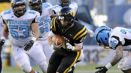 North Allegheny quarterback Mack Leftwich carries against Woodland Hills Friday in the WPIAL class AAAA championships at Heinz Field.