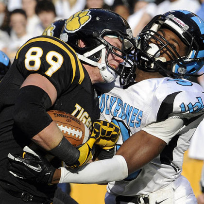 North Allegheny's Zach Lyon runs into the end zone for a touchdown as he's defended by Woodland Hills' Trevon Mathis Friday in the WPIAL class AAAA championships at Heinz Field.