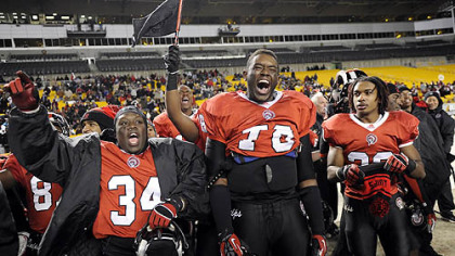 Aliquippa teammates celebrate during the final seconds of their 34-7 win against Washington Friday in the WPIAL class AA championships at Heinz Field.