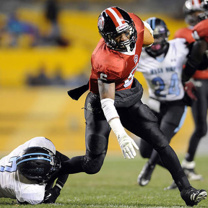 Aliquippa&#039;s Dravon Henry carries as he&#039;s defended by Washington&#039;s Mijerean Witcher Friday in the WPIAL class AA championships at Heinz Field.