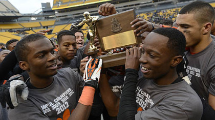 The Bears hold their WPIAL Championship trophy up after their 58-21 win against Sto-Rox Friday at Heinz Field.