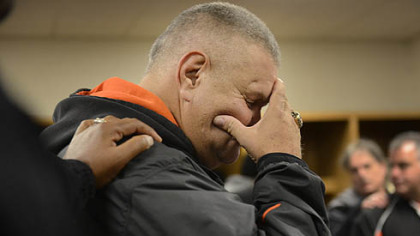 "Head coach Tom Nola is overcome with emotion in the locker room after the Bears 58-21 win over Sto-Rox Friday at Heinz Field.  ""You guys are great.  You have done amazing things,"" he told the team."