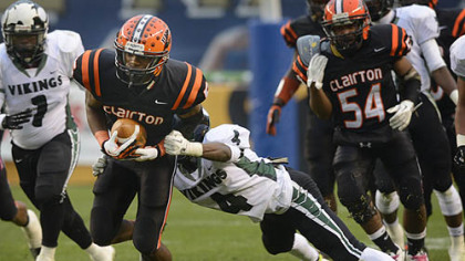 Clairton Junior Terrish Webb carries the ball while Shakelford Ben attempts the tackle Friday at Heinz Field. The Bears set a Pennsylvania record with its 60th consecutive victory, a 58-21 win against Sto-Rox in the WPIAL Class A title game.