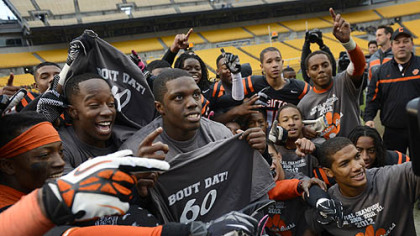 "The Bears celebrate their record-breaking win with ""Bout Dat"" t-shirts  Friday at Heinz Field."