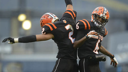 Clairton Bears Trenton Coles (left) and Titus Howard celebrate Coles touchdown Friday at Heinz Field. The Bears set a Pennsylvania record with its 60th consecutive victory, a 58-21 win against Sto-Rox in the WPIAL Class A title game.