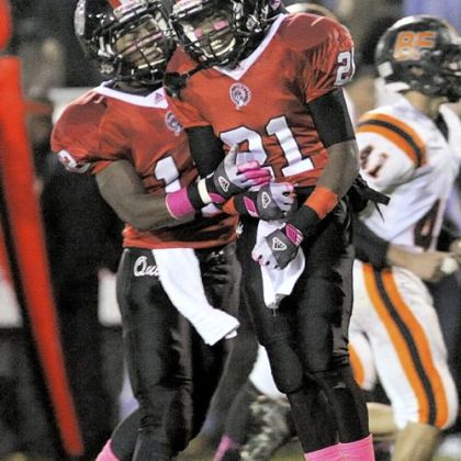 Aliquippa's Terry Swanson, left, congratulates teammate Shaquere McBride on scoring the first touchdown of the game Oct. 18 against Beaver Falls.