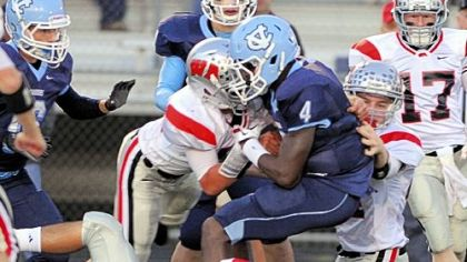 West Allegheny's swarming defenders made things tough for opponents all season, including Central Valley star Robert Foster shown here being tackled in a September game. The Indians have allowed only 26 points in their past seven games.