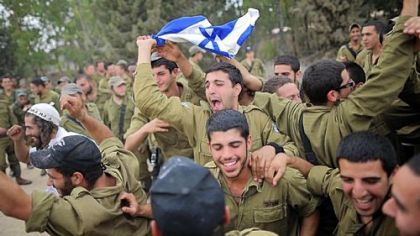 Israeli soldiers dance Thursday to music provided by Hassidic Jews who visited to show their support to soldiers at the border with the Gaza Strip.