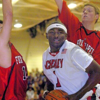 Schenley's Greg Blair grabs a rebound against Fox Chapel in a 2007 game. Blair, the younger brother of NBA player DeJuan Blair is finishing his senior season as a football player at the University of Cincinnati.