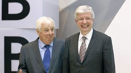Tony Hall, right, the new director general of the BBC, and Chris Patten, the head of the BBC Trust, joke before a news conference Thursday in London.