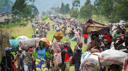 Thousands of Congolese flee the town of Sake, west of Goma, following fresh fighting in the eastern Democratic Republic of the Congo town Thursday. Fighting broke out that afternoon, causing people to flee the town and head to camps for the internally displaced in the village of Mugunga.