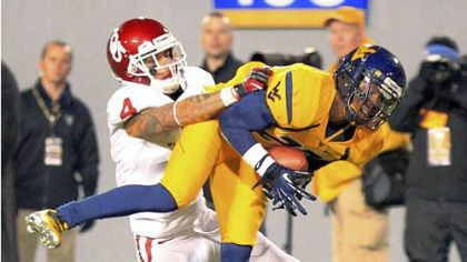 West Virginia's Brodrick Jenkins (23) intercepts a pass over Oklahoma's Kenny Stills (4) Saturday in Morgantown, W.Va.