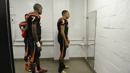 For young, aspiring football players in Clairton, this is the culmination of years of hard work: wearing the orange and black of the varsity team and maybe someday lifting the state championship trophy. From left, Vinny Moody (No. 8), Dakota Halcomb (No. 7) and Bryan Clifford give their uniforms a final check before taking the field in October.
