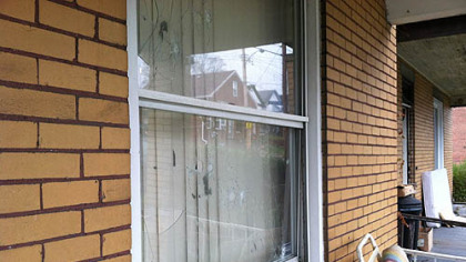 The aftermath of gunfire sprayed on a home in the 600 block of Waddell Avenue, where a family of six was home but no on was injured.