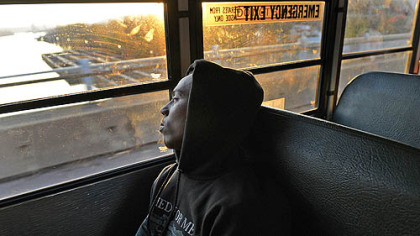 Clairton running back Tyus Booker and his teammates ride in silence as their bus crosses the Monongahela River Nov. 9 on the way to a playoff game in Belle Vernon.