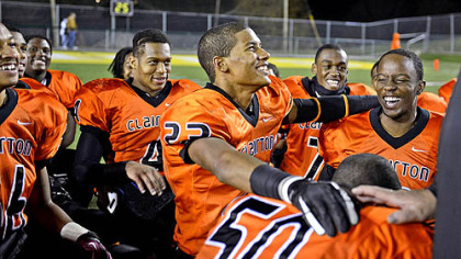 Tyler Boyd, center, and Armani Ford, right, kneel together with their teammates for the Lord's Prayer, a pre- and post-game tradition, after beating Brentwood in the WPIAL Class A quarterfinals, 39-0, in Belle Vernon.
