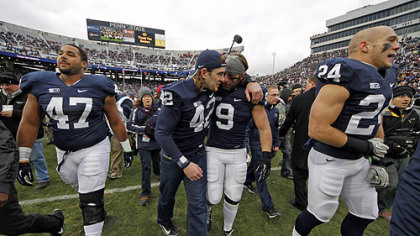 Penn State defensive lineman Jordan Hill (47), linebacker Michael Mauti (42), running back Michael Zordich (9) and running back Derek Day (24) walk off the field after a senior recognition ceremony.