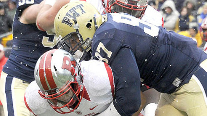 Pitt&#039;s Aaron Donald sacks Rutgers quarterback Gary Nova in the second quarter this afternoon at Heinz Field.