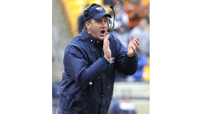 Pitt head coach Paul Chryst applauds his team&#039;&#039;s effort against Rutgers in the second quarter this afternoon at Heinz Field.