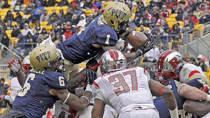 Pitt&#039;s Ray Graham dives into the end zone for a touchdown against Rutgers in the second quarter this afternoon at Heinz Field.