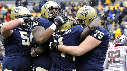 Pitt&#039;s Ray Graham is congratulated after a touchdown against Rutgers in the second quarter this afternoon at Heinz Field.