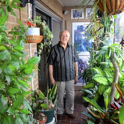 Saul Kaufman loves his balcony jam packed with plants at Dithridge House in North Oakland.