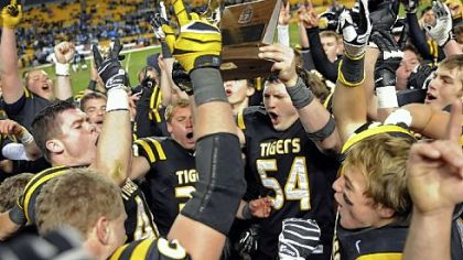 North Allegheny players celebrate their win Friday against Woodland Hills in the WPIAL Class AAAA championship at Heinz Field.