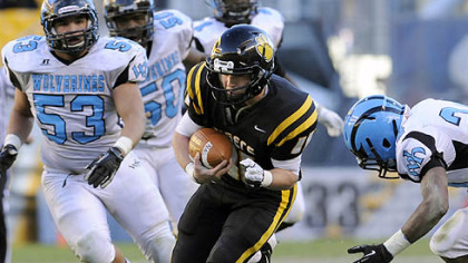 North Allegheny quarterback Mack Leftwich carries against Woodland Hills Friday in the WPIAL Class AAAA championship at Heinz Field.