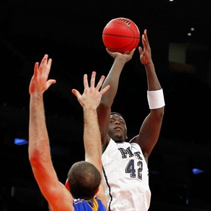 Pitt forward Talib Zanna shoots over Delaware's Carl Baptiste Friday at Madison Square Garden in New York.
