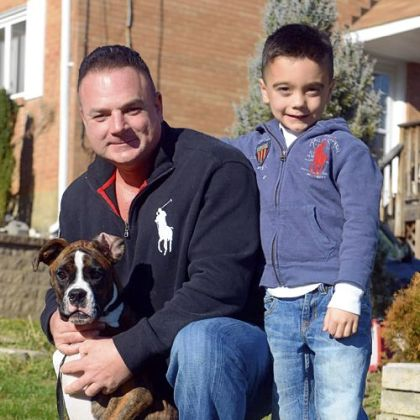 Joey Deiuliis with his son Gavin, 6, and Bowser, their 6-month-old boxer.