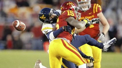 West Virginia safety Darwin Cook, left, breaks up a pass indented for Iowa State wide receiver Chris Young Friday in Ames, Iowa. West Virginia won, 31-24.