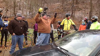 Ron Lutz, a team's organizers, gives cautionary instructions to his group before the