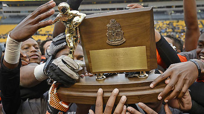 The Clairton Bears raise their WPIAL Class A championship trophy after their 58-21 win over Sto-Rox Friday at Heinz Field secured their 60th consecutive victory and a new state record.