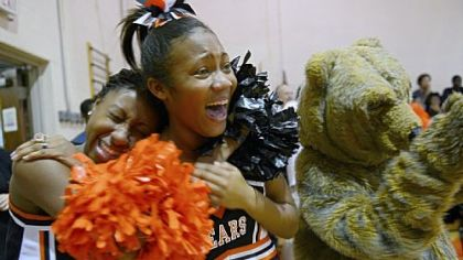 Cheerleaders Tori James, 17, left, and Coreiona Wright, 14, laugh while the football players are acknowledged during a pep rally on Nov. 8.