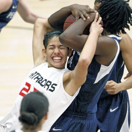 Cal State Northridge's Violet Alama, left, and Penn State''s Nikki Greene fight for a loose ball in the second half of a women's game in the Radisson Hotel Chatsworth Thanksgiving tournament, in Northridge, Calif.  Penn State won 85-73.