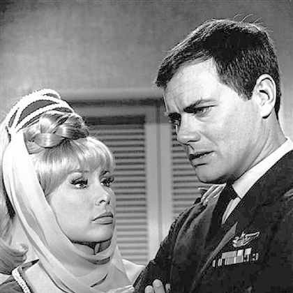 "Larry Hagman is shown with his ""I Dream of Jeannie"" co-star Barbara Eden in 1967."