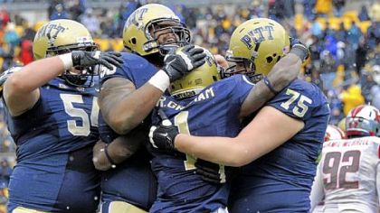 Pitt's Ray Graham, center, is congratulated after a touchdown against Rutgers in the second quarter Saturday at Heinz Field.
