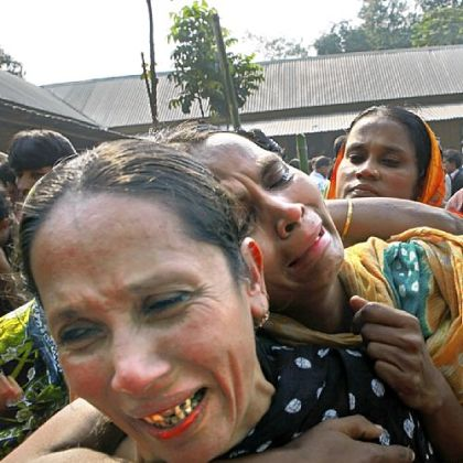 Relatives of garment factory workers killed in a fire cry as they come Sunday to collect bodies from a mortuary in Dhaka, Bangladesh.