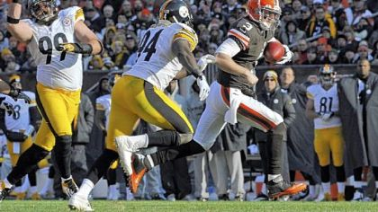 Browns quarterback Brandon Weeden evades Lawrence Timmons in the second quarter Sunday in Cleveland.