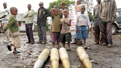Boys look over tank shells left behind Wednesday by retreating government troops as they fled an assault by M23 rebels in eastern Congo.