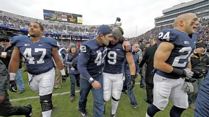 Penn State linebacker Michael Mauti (42) embraces running back Michael Zordich (9) as they walk off the field after a senior recognition ceremony before Saturday's game against Wisconsin in University Park, Pa.