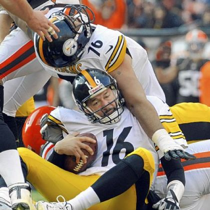Steelers lineman Mike Adams lands on top of quarterback Charlie Batch after Batch was sacked against the Browns Sunday in Cleveland.