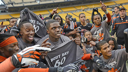 The Clairton Bears celebrate their state-record-breaking 60th consecutive victory after defeating Sto-Rox, 58-21, to take home the WPIAL Class A championship Friday at Heinz Field.