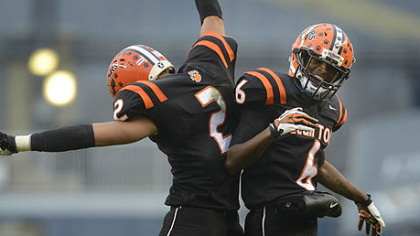 Clairton Bears Santeaun Sims (left) and Titus Howard celebrate Coles touchdown Friday at Heinz Field. The Bears set a Pennsylvania record with its 60th consecutive victory, a 58-21 win against Sto-Rox in the WPIAL Class A title game.
